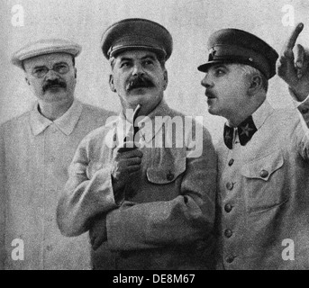 Vyacheslav Molotov, Joseph Stalin and Kliment Voroshilov on the Central Aerodrome, June 25, 1937, 1937. - Stock Photo