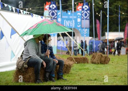 Portmeirion, North Wales UK . 13th Sep, 2013. People sheltering from the rain at the second Festival Number 6, in - Stock Photo