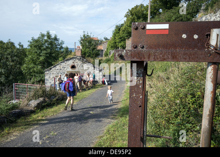 Pilgrims stopping for refreshments in the small village of La Roche on the GR65 walking route The Way of St James - Stock Photo