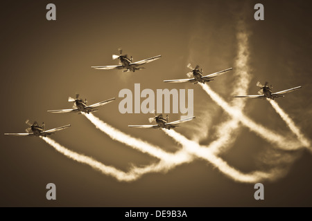 Aerobatic Group Formation In Sky During Air Show - Stock Photo