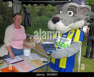 Warrington Wolves Mascot Wolfie at Grappenhall Walking Day, Community Library stall, Warrington, Cheshire,England,UK - Stock Photo