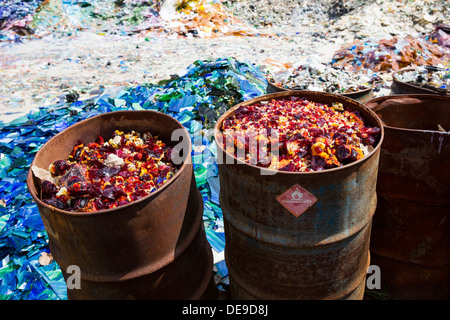A scrap glass yard including stained glass and marbles. - Stock Photo