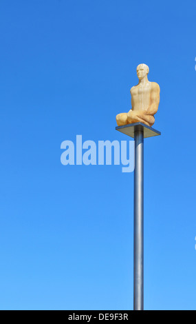 Modern statue depicting a man kneeling overlooks Place Massena in Nice, France - Stock Photo