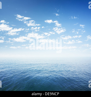 blue sky over sea or ocean water surface - Stock Photo
