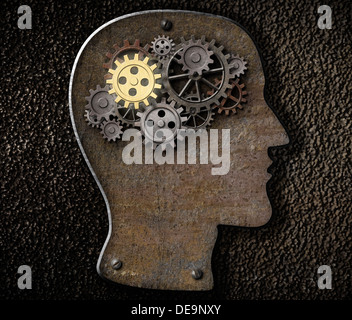 Brain mechanism gears and cogs made from rusty metal - Stock Photo