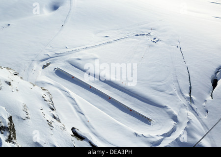 Snow Fun at Jungfraujoch in Switzerland. A nice sunny day above the clouds. - Stock Photo