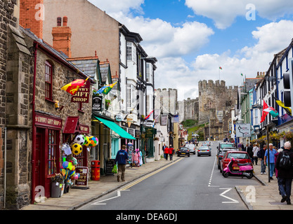 View down Castle Street towards Conwy Castle, Conwy, North Wales, UK - Stock Photo