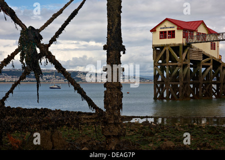 Mumbles Lifeboat house and pier supports at low tide - Stock Photo