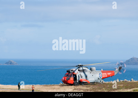 Royal Navy helicopter on the ground at Lands End, England. - Stock Photo