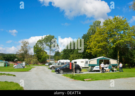 Tents and caravans at the Croft campsite in the village of Hawkshead, Lake District National Park, Cumbria, England - Stock Photo
