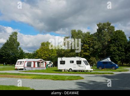 Caravans and campervan in the Croft Campsite, Hawkshead, Lake District National Park, Cumbria, England UK - Stock Photo