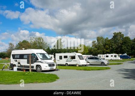 Motorhomes and caravans in the Croft Campsite, Hawkshead, Lake District National Park, Cumbria, England UK - Stock Photo