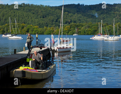 Windermere Lake warden in boat, Ferry Nab, Lake Windermere, Lake District National Park, Cumbria, England UK - Stock Photo