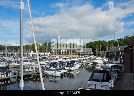 Boats moored in Windermere Marina Village, Lake Windermere, near Bowness, Cumbria, England UK - Stock Photo