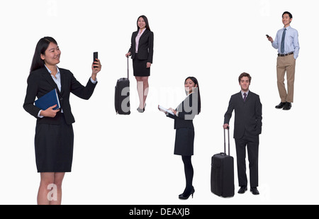 Group of business people working, taking photos, texting, studio shot, full length - Stock Photo