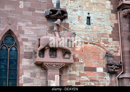 George and a dragon, carving in stone on outer wall of Basel Cathedral, Switzerland, Europe - Stock Photo