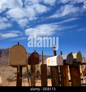 Mailboxes mail box aged vintage in west California desert - Stock Photo