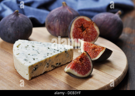 blue cheese and fresh figs fruit on a wooden cutting board - Stock Photo