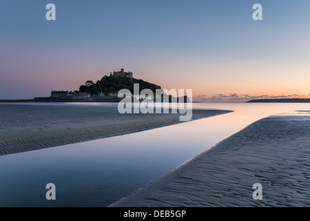 Dusk at St Michael's Mount off the shore at Marazion near Penzance in Cornwall - Stock Photo