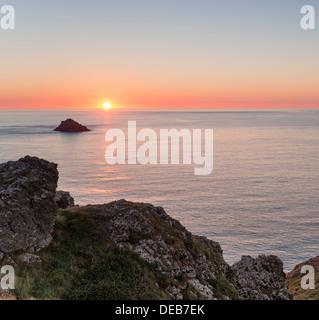 Sunset over the Rumps on Pentire Headland on Cornwall's Atlantic coast - Stock Photo