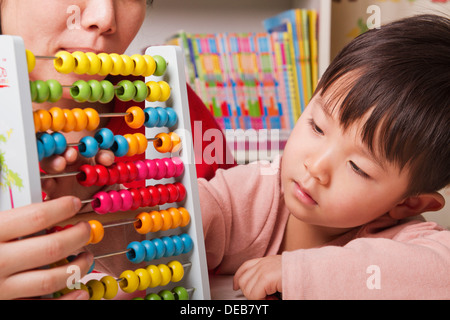 Boy Playing with Abacus - Stock Photo
