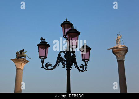 A colourful lamp against a clear sky with monuments in the background - Stock Photo