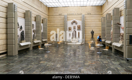 people browse sculpture display in daylit entrance court with marble clad walls slate floor Art Deco Seattle Asian - Stock Photo