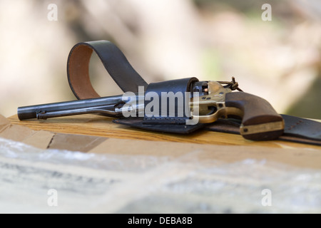 Antique revolver lying on a table - Stock Photo