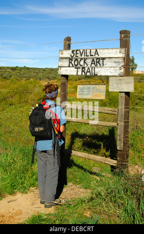 Visitor at the entrance to the Sevilla Rock Art Trail, site of prehistoric rock paintings of the Bushmen, Cederberg - Stock Photo