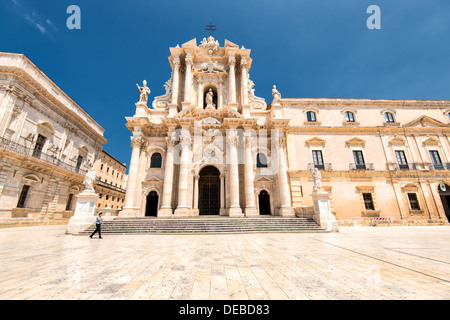 Piazza Duomo and the Cathedral at Syracuse in Sicily on sunny day in July. - Stock Photo