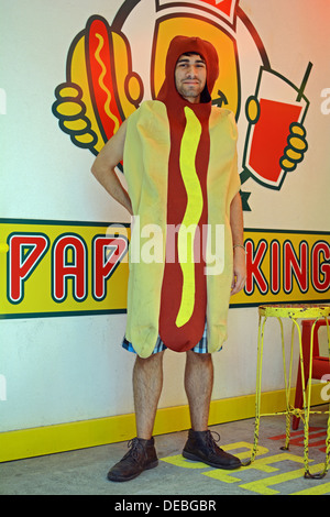 Portrait of a young man named Ruben who works on the streets for New York's Papaya King dressed as a hot dog. - Stock Photo