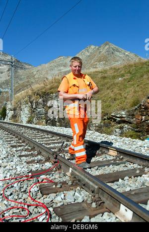 Gruem Alp, Switzerland, the Rhaetian Railway electrician when working on the Bernina Line - Stock Photo