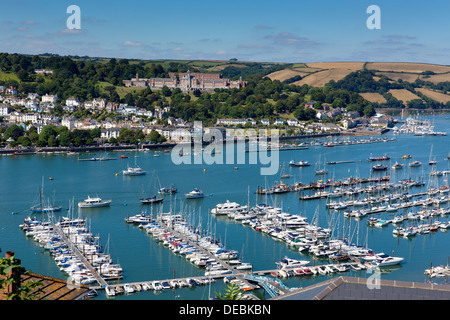 Naval College on hillside Dartmouth Devon with River Dart boats and yachts in historic English coast town with blue - Stock Photo