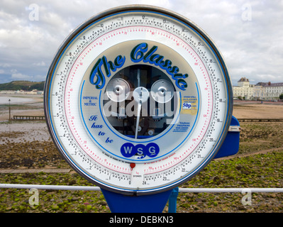 Old weighing machine on the pier in Llandudno, North Wales, UK - Stock Photo