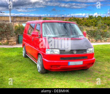 Red Volkswagen VW T4 van alloy wheels and blue sky like painting in HDR - Stock Photo