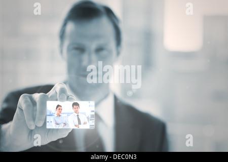 Businessman presenting digital interface - Stock Photo