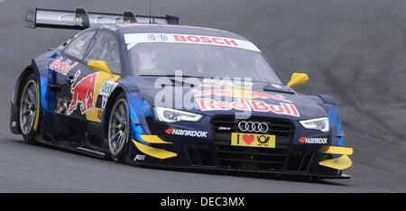 Oschersleben, Germany. 15th Sep, 2013. The British Audi-Pilot Jamie Green drives his race car on the racetrack of - Stock Photo