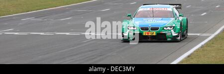 Oschersleben, Germany. 15th Sep, 2013. The Brazilian BMW-Pilot Augusto Farfus drives his race car on the racetrack - Stock Photo