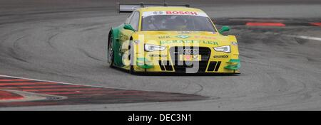 Oschersleben, Germany. 15th Sep, 2013. The German Audi-Pilot Mike Rockenfeller drives his race car on the racetrack - Stock Photo