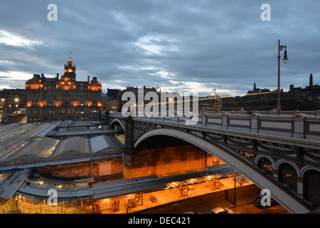 Views of the old town illuminated in the evening with the tower of the Balmoral Hotel, Waverley Station, Calton - Stock Photo