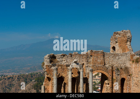 A view of the Greek Theatre and Mt. Etna in Taormina, Sicily, Italy