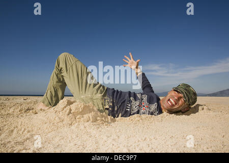 Man Coming Out of a Ditch - Stock Photo