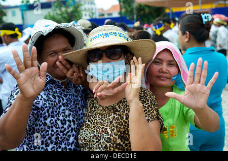 Phnom Penh, Cambodia on Sept. 16th, 2013. Sam Rainsy supporters showing #7 in harmony w/ their hands while protesting - Stock Photo