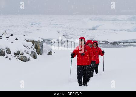 Guests from the Lindblad Expedition ship National Geographic Explorer enjoy hiking in Antarctica - Stock Photo