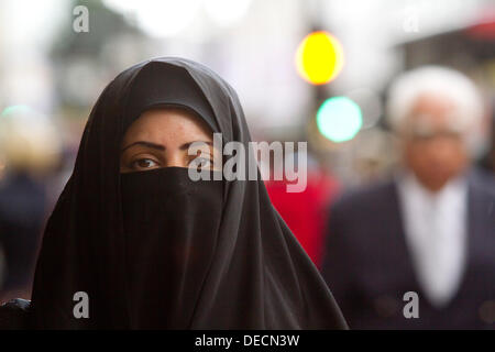 Oxford Street, London, UK. 16th Sep, 2013. A woman walks in Oxford street dressed in a  full face veil as a  British - Stock Photo