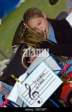 12 year old girl playing in her local brass band, Hampshire, UK. - Stock Photo
