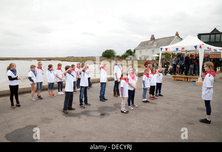 Local village children dancing the hornpipe on the quay, Orford, Suffolk England UK - Stock Photo