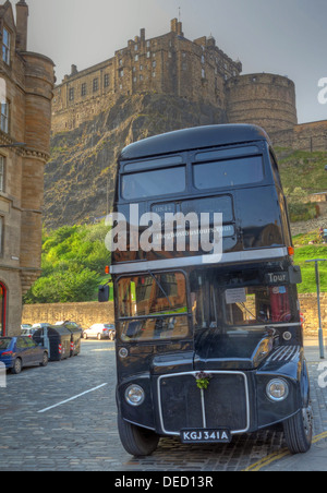 The black London Necrobus, in Edinburgh, Scotland, UK with castle behind. - Stock Photo