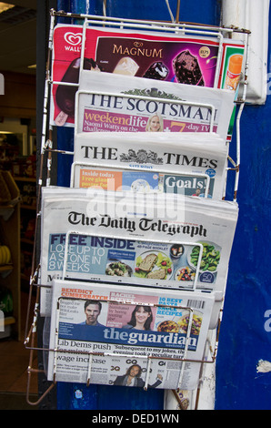 A selection of British daily newspapers outside a newsagents shop on the Royal Mile in Edinburgh. - Stock Photo