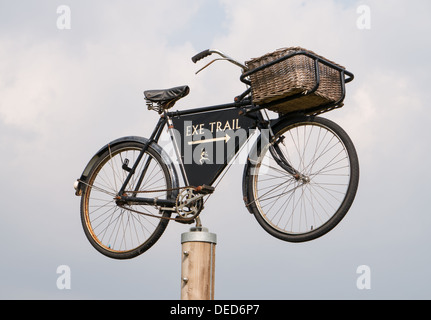A delivery bicycle used as a way marker or signpost on the Exe cycle trail Devon, England, UK - Stock Photo